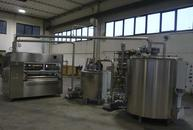 Enrobing machine with 2 tanks melter