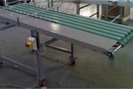 Conveyor with belts with spheres of containment for high-speed paper sheets