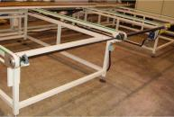 Conveyor with timing belts for profiles in aluminium