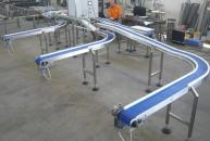 Conveyors with plastic modular belt for conveying to the packaging