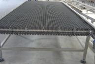 Conveyor with stainless steel mesh wire for trays on outlet oven