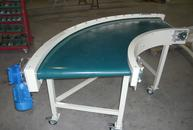 90° belt conveyor with conical rollers in painted steel structure